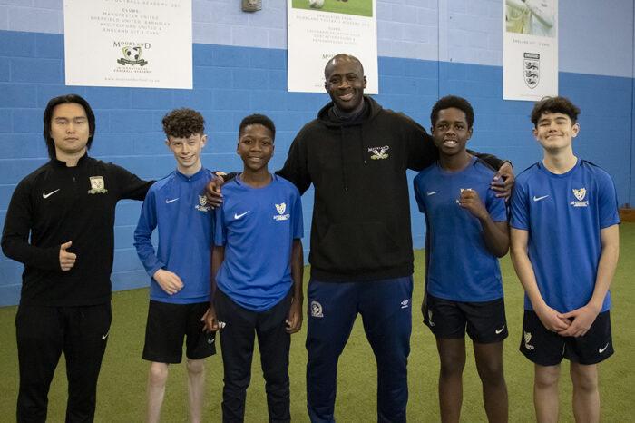 Yaya Toure posing with students