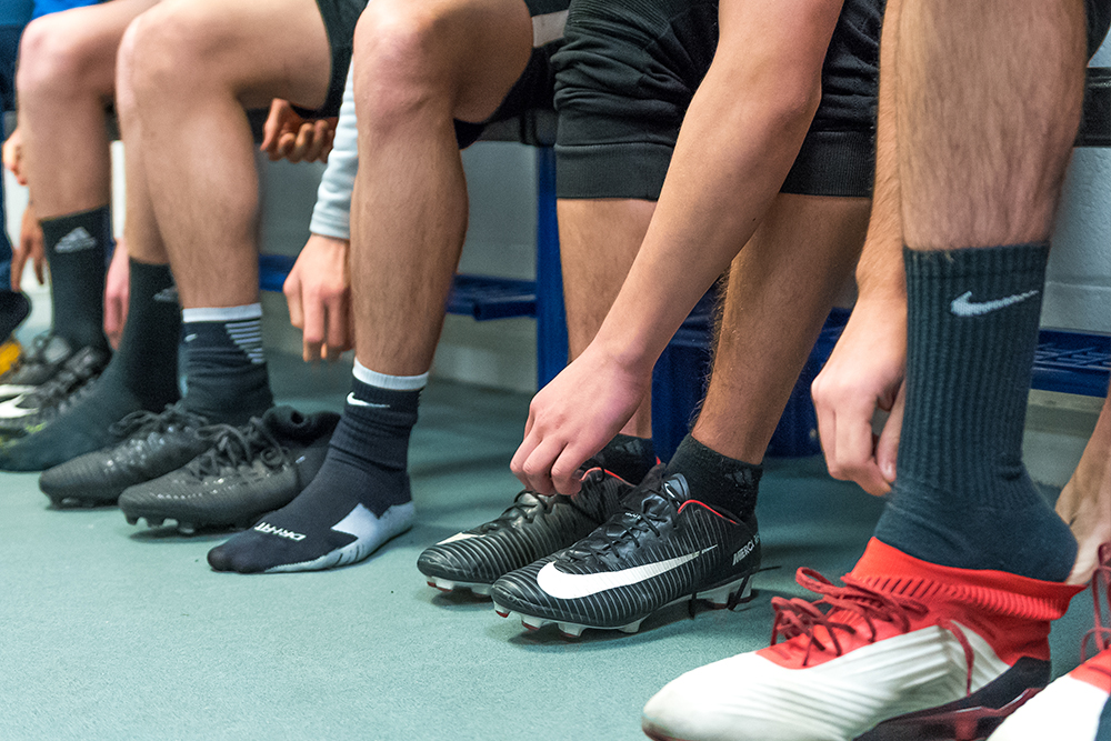 Players putting on their football boots