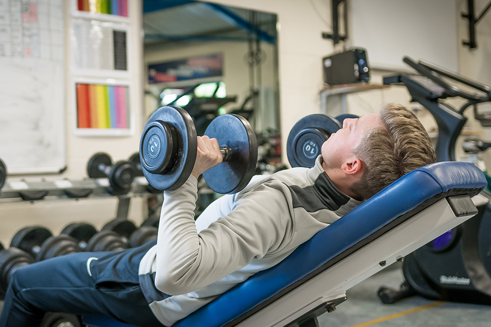 Student training with dumbells