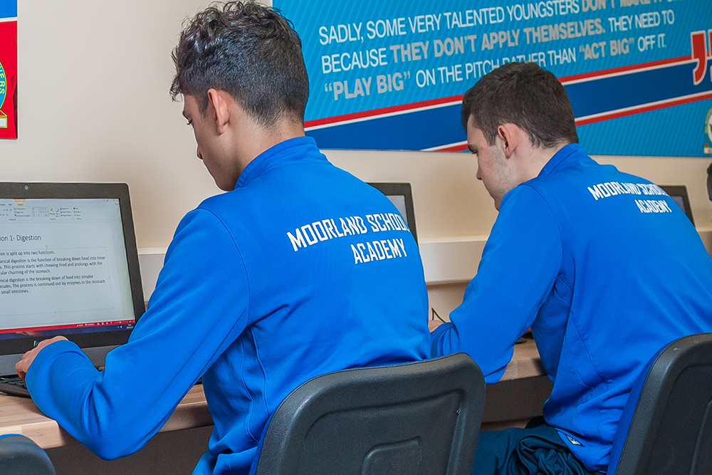 Two students completing work on the computer